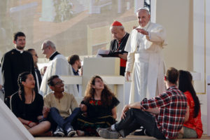 Pope Francis blesses youths ahead of a prayer vigil on the occasion of the World Youth Days, in Campus Misericordiae in Brzegi, near Krakow, Poland, Saturday, July 30, 2016. The 79-year-old Francis has had an unrelenting schedule since he arrived in Poland on Wednesday for World Youth Days, a global Catholic gathering which culminates Sunday. (AP Photo/Gregorio Borgia)